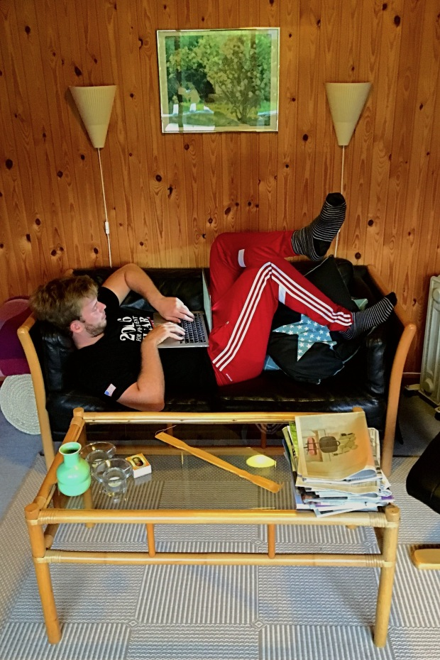 boy studying on a couch in Denmark