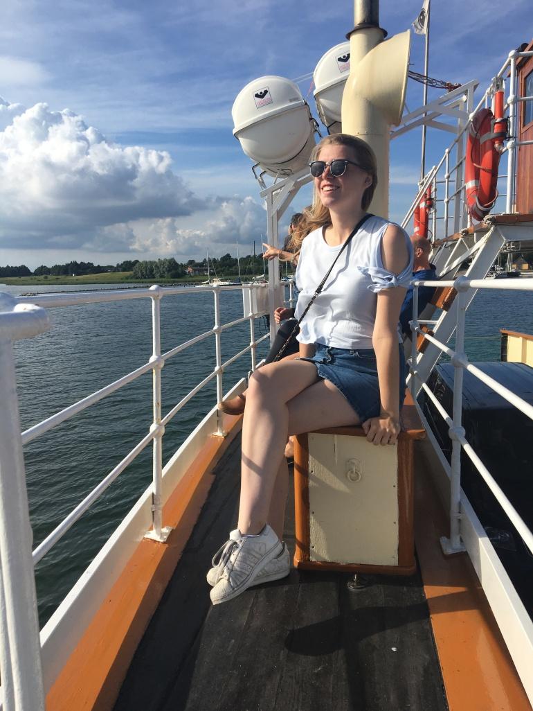 girl in sunglasses on boat in Denmark