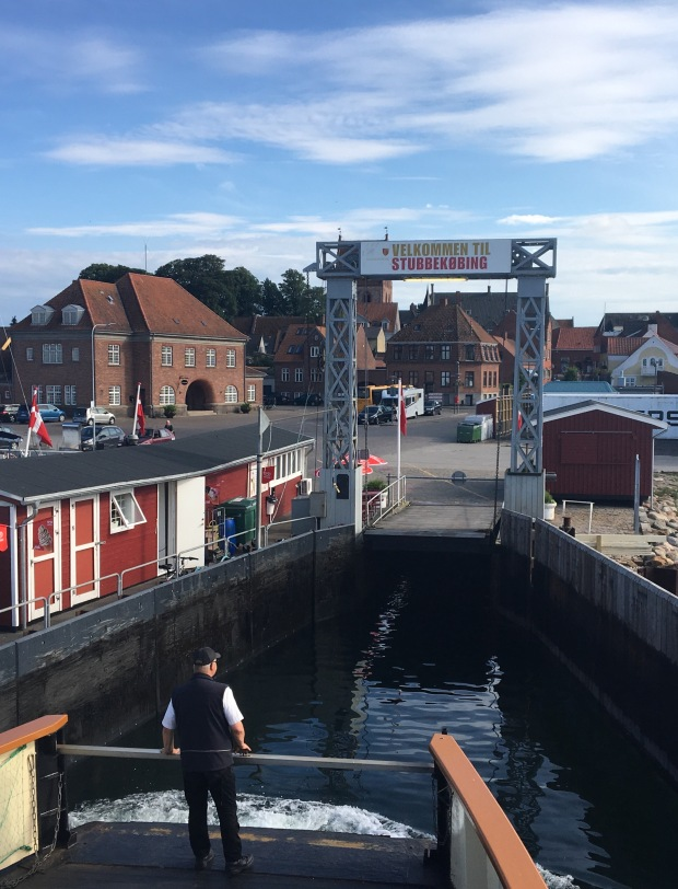 ferry and a welcome to stubbekøbing sign in Denmark