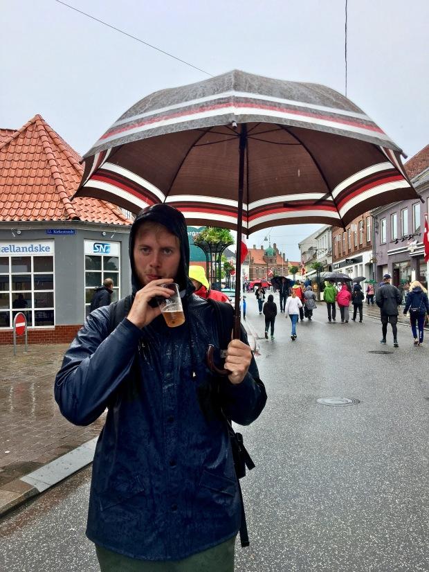 boy drinking under umbrella at Stege Market in Denmark