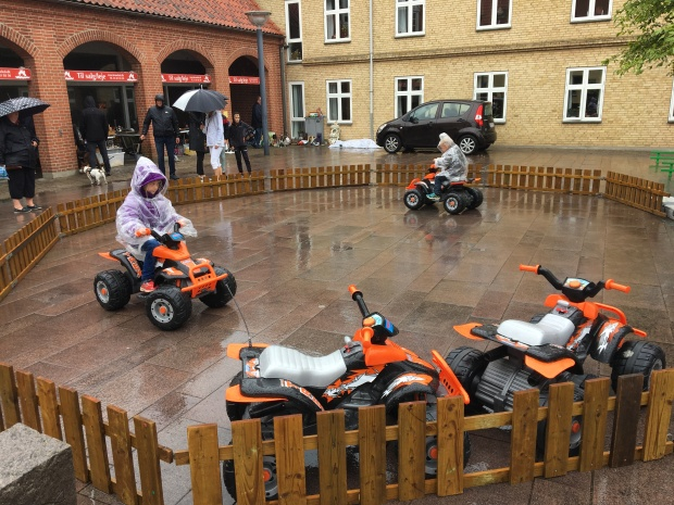 Kids on motorbikes at Stege Market in denmark