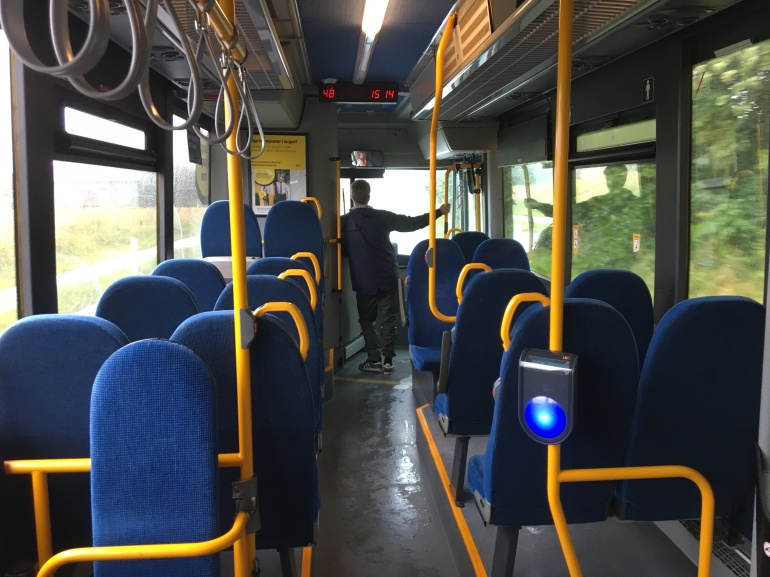 boy talking to bus driver on a bus in Denmark