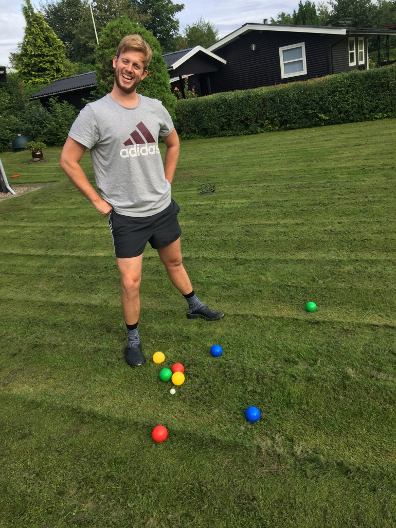 handsome guy and yard game bocce ball