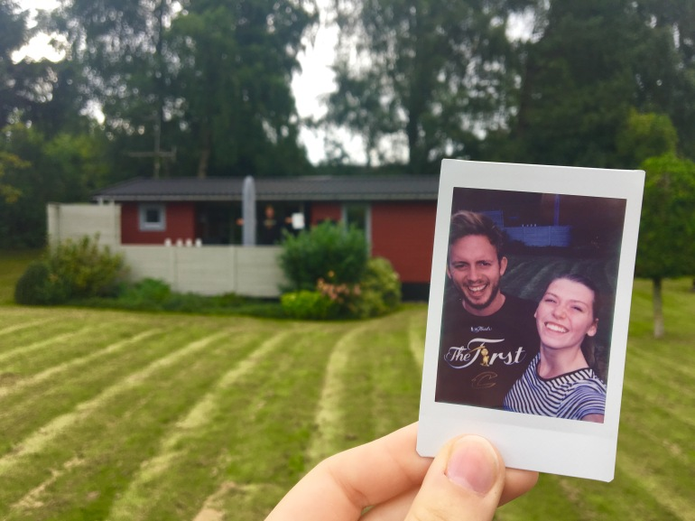 polaroid picture in front of summer house in Denmark